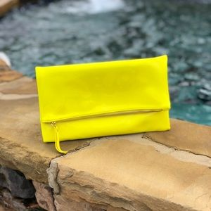 Patent leather yellow clutch